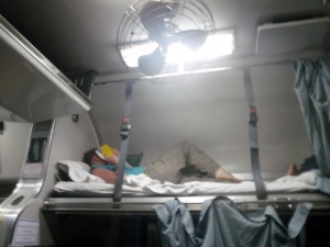 The upper berth with straps so you don't roll out